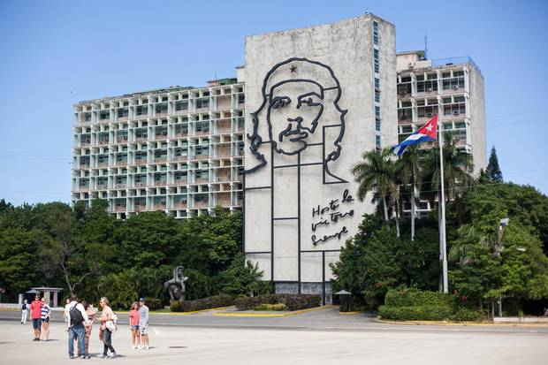 Tourists visit a museum in the Plaza de la Revolucion in Havana. The plaza often hosts political events and other public events.