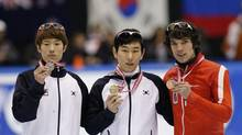 Silver medalist Sin Da-woon (L-R) and gold medalist Kim Byeong-jun from South Korea pose with bronze medalist Charles Hamelin from Canada after the men's 1,500 meter final during the ISU Short Track World Cup competition in Nagoya, central Japan, December 1, 2012. (KIM KYUNG-HOON/REUTERS)