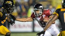 Calgary Stampeders' Jon Cornish runs the ball against the Hamilton Tiger Cats during fourth quarter CFL action at Ivor Wynne Stadium in Hamilton, Ontario, Thursday, Aug. 9, 2012. (CP)