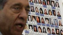 Photographs of missing women are displayed as Commissioner Wally Oppal speaks during the Missing Women Commission of Inquiry public forum in Vancouver on Wednesday Jan. 19, 2011. (Darryl Dyck/ The Canadian Press/Darryl Dyck/ The Canadian Press)