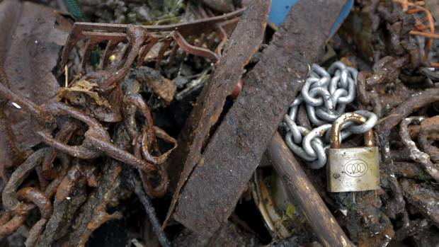 A lock and chain, rusted scrap metal, and a rake are some of the items collected during the Surfrider Pacific Rim Christmas Jingle Cleanup Event along the Tofino harbour shorefront near the 4th Street government dock and marina on Dec. 2, 2016.