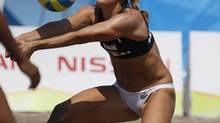 Canada's Heather Bansley sets the ball in a women's beach volleyball quarterfinal match against Brazil at the Pan American Games in Puerto Vallarta, Mexico, Wednesday Oct. 19, 2011. (Ariana Cubillos/The Associated Press)