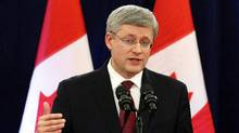 Canada's Prime Minister Stephen Harper speaks during a news conference about foreign takeovers on Parliament Hill in Ottawa, Dec. 7, 2012./ (Chris Wattie/Reuters)