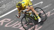 Europcar rider Thomas Voeckler of France wears the leader's yellow jersey as he rides on a mountain during the 12th stage of the Tour de France 2011 cycling race from Cugnaux to Luz-Ardiden July 14, 2011. (STEFANO RELLANDINI/REUTERS)