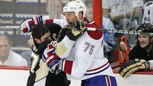Pittsburgh Penguins Sidney Crosby (L) collides with Montreal Canadiens Hal Gill during the second period of action in Game 2 of their NHL Eastern Conference semi-final hockey series in Pittsburgh, Pennsylvania, May 2, 2010. (JASON COHN/REUTERS)