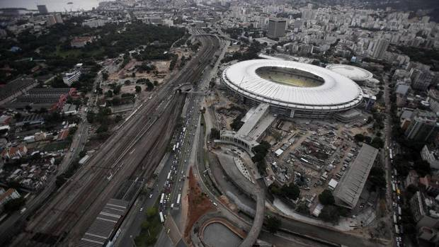An aerial view shows the final touches of the roof installation at the Maracana Stadium on April 9, 2013, as it undergoes renovations in preparation for the 2013 Confederations Cup and 2014 World Cup in Rio de Janeiro. The stadium will also host games for the Rio 2016 Olympic Games. (RICARDO MORAES/REUTERS)
