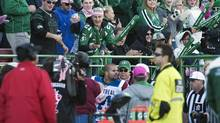 The crowd taunts Montreal Alouettes linebacker Shea Emry as he is escorted off the field after being given a game misconduct during the first half of CFL action against the Saskatchewan Roughriders in Regina, Sask., Saturday, October 20, 2012 (Liam Richards/THE CANADIAN PRESS)