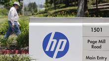 The main entrance of Hewlett-Packard headquarters in Palo Alto, Calif. HP is the world's largest PC and printer firm and one of the biggest players in servers, computer storage equipment, networking gear and tech services. But for much of the last decade, it has floundered, led in conflicting directions by four different CEOs. (Paul Sakuma/Associated Press/Paul Sakuma/Associated Press)