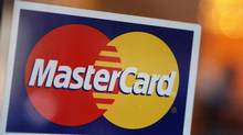 A MasterCard logo is seen on a door outside a restaurant in New York, on Feb. 3, 2010. (SHANNON STAPLETON/REUTERS)