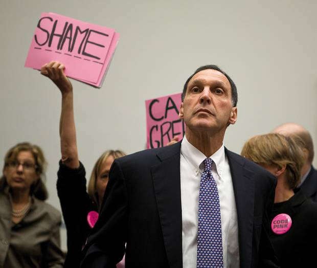 "Richard S. Fuld Jr., Chairman and CEO of Lehman Brothers investment bank testifies before the House Oversight and Government Reform Committee on Capitol Hill, as protesters from ""Code Pink"" wave signs reading ""Shame"". Code Pink is a women- initiated grassroots peace and social justice movement. Washington DC, USA, 2008. Lehman Brothers filed for Chapter 11 bankruptcy protection on 15 September, 2008. The filing remains the largest bankruptcy filing in U.S. history, with Lehman holding over $600 billion in assets."