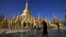 A Buddhist monk walks on the grounds of the Shwedagon pagoda in Rangoon on March 18, 2013. After 25 years of almost no contact between Canada and Myanmar, Ottawa will launch an era of new and hopefully warmer ties this spring by opening an embassy in Rangoon and appointing a veteran Asia hand as the first ambassador there. (Soe Zeya Tun/Reuters)