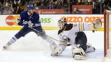 Toronto Maple Leafs James van Riemsdyk (L) scores on Buffalo Sabres goalie Ryan Miller (R) during the second period of their NHL game in Toronto February 21, 2013. (AARON HARRIS/REUTERS)