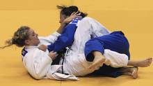 Kelita Zupancic, left, of Canada challenges Yoriko Kunihara of Japan during their women's under 70 kg semi-final at the IJF Grand Slam judo tournament in Rio de Janeiro June 19, 2011. (Reuters)