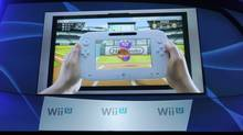 The new Nintendo Wii U gaming console is displayed on a video screen during a news conference at the E3 Gaming Convention in Los Angeles, Tuesday, June 7, 2011. (Chris Pizzello/AP)