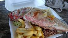 Cheap, tasty grilled fish is available from Anguilla's roadside food trucks. (Amy Rosen for The Globe and Mail)