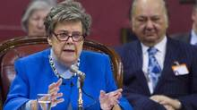 Former supreme court judge Claire L'Heureux Dube testifies at a legislature committee studying the proposed Quebec Charter of Values Friday, Feb. 7, 2014 at Quebec City. In background is lawyer Andre Jolicoeur. (Clement Allard/THE CANADIAN PRESS)