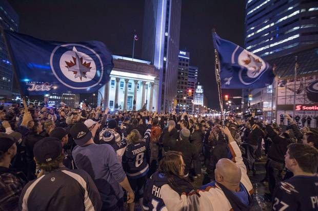 2015: Fans of the revived Winnipeg Jets team gather at Portage and Main to celebrate the team clinching an NHL playoff spot.