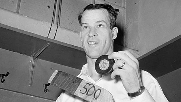 Gordie Howe of the Detroit Red Wings poses with the hockey puck in the dressing room at Madison Square Garden after he scored the 500th goal of his National Hockey League career in New York City, March 14, 1962. The man known as Mr. Hockey has died. The Detroit Red Wings say Gordie Howe has died at age 88.