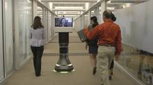 Five to 10 per cent of the company's revenue comes from its newer products, such as a device that allows a monitor to move around an office or plant during a video conference. (iROBOT)