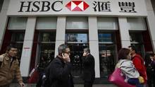 People walk outside one of the branches of HSBC in Hong Kong March 4, 2013. HSBC, Europe's largest bank, was fined $1.9-billion (U.S.) last year for financial irregularities in Mexico and the United States. (BOBBY YIP/REUTERS)