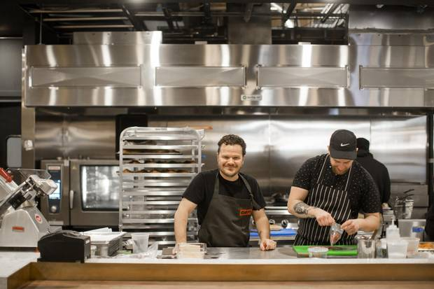 Chef Rob Bragagnolo, centre, and Chef de cuisine Jesse Mutch in the kitchen at Campo.