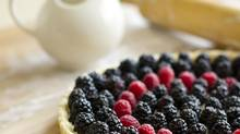 This blackberry-raspberry ricotta tart includes a drizzle of warm, smoky syrup. (Kevin Van Paassen For The Globe and Mail)