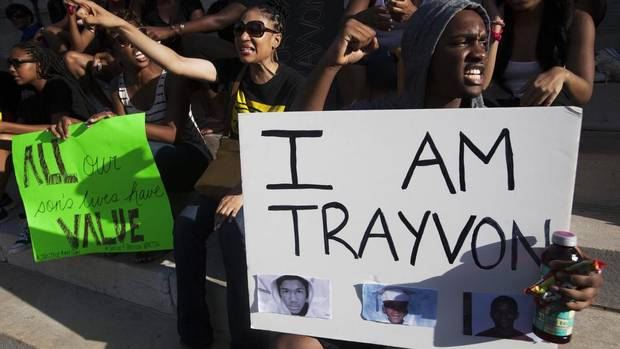 Protesters, clad in hoodies and clutching bags of Skittles candy and bottles of iced tea like those Trayvon Martin was carrying when he died, gathered to denounce acquittal of George Zimmerman in Brooklyn, N.Y., on July 14, 2013. (KEITH BEDFORD/REUTERS)