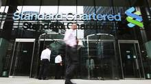 An exterior view of the Standard Chartered headquarters is seen in London, Aug. 7, 2012. (OLIVIA HARRIS/Reuters)