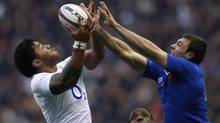 France's Vincent Clerc (R) and England's Manu Tuilagi jump for the ball during their Six Nations rugby match at Twickenham stadium in London February 23, 2013. (EDDIE KEOGH/REUTERS)