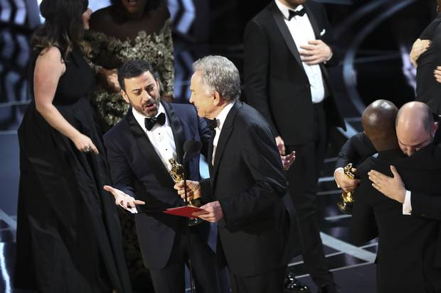 Jimmy Kimmel questions presenter Warren Beatty after he showed the card for Best Picture winner