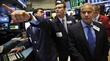 Specialist trader Joseph Dreyer (L) speaks with governor Patrick King (C) and NYSE managing director Rudy Mass (R) before opening a stock after the bell on the floor at the New York Stock Exchange, July 18, 2013. (BRENDAN MCDERMID/REUTERS)