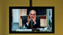 CRTC chairman Konrad von Finckenstein is seen on a TV screen the regulator's hearings in Gatineau, Que., on Nov. 12, 2009. (Sean Kilpatrick/The Canadian Press)