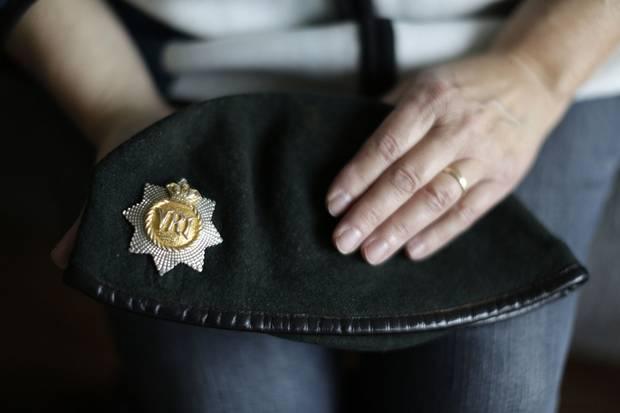 Anita Cenerini holds her son's beret.