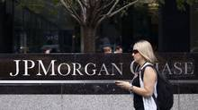 A woman walks past JPMorgan Chase's international headquarters on Park Avenue in New York in this file photo. (Andrew Burton/Reuters)