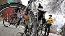 On a recent one-day bicycle-blitz Police Constable Blair Begbie handed out warnings to cyclists who rode through this four-way stop in downtown Toronto without stopping. The fine for a cyclist is the same as it would be for a motor vehicle. (Peter Power/Peter Power/The Globe and Mail)