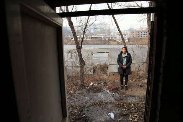 Songting resident Zhao Xiuying's house lies a short distance from some of the massive steelworks that surround the village. Ms. Zhao and other villagers have protested the stifling smog they often endure.