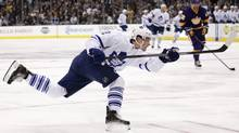 Toronto Maple Leafs' Mason Raymond shoots to score against the Los Angeles Kings during the third period of an NHL hockey game on Thursday, March 13, 2014, in Los Angeles. The Maple Leafs won 3-2. (Associated Press)