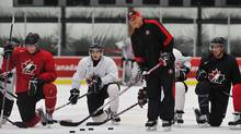 Canada's head coach Don Hay runs through drills in a practice the day after the team's crushing loss to the Russians. (Todd Korol/Reuters/Todd Korol/Reuters)