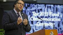 Calgary Mayor Naheed Nenshi gestures during a ceremony commemorating the first anniversary of devastating floods that hit Calgary in 2013, at city hall in Calgary, Friday, June 20, 2014. (Jeff McIntosh/THE CANADIAN PRESS)