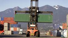Cargo is unloaded from a ship at the Centerm terminal in Vancouver February 11. (Jeff Vinnick/The Globe and Mail)