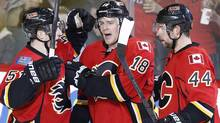 Calgary Flames' Matt Stajan, centre, celebrates his goal against the Los Angeles Kings with Kenny Agostino, left, and Chris Butler during second period NHL action in Calgary, Alta., Wednesday, April 9, 2014. (The Canadian Press)