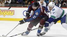 Peter Forsberg, seen in this 2008 file photo battling Vancouver defenceman Sami Salo, is continuing his career with Modo of the Swedish Elite League. (David Zalubowski/AP)