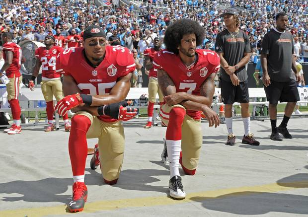 San Francisco 49ers safety Eric Reid, left, and quarterback Colin Kaepernick kneel during the national anthem before an NFL game against the Carolina Panthers in Charlotte on Sunday.