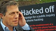 British actor Hugh Grant outside the Houses of Parliament in London, where a debate was being held into the allegations of phone hacking by journalists Wednesday July 6, 2011. (Stefan Rousseau/Stefan Rousseau / AP)