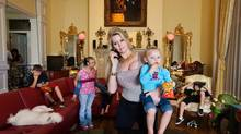 "This image released by Magnolia Pictures shows Jackie Siegel and her children from the documentary ""The Queen of Versailles."" (Lauren Greenfield/AP)"