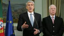 Portuguese Prime Minister Jose Socrates, left, on Tuesday makes a statement next to Finance Minister Fernando Teixeira dos Santos (HO/REUTERS)