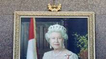 A portrait of the Queen hangs in the entrance to the Department of Foreign Affairs building in Ottawa, on July 26, 2011. (Adrian Wyld/THE CANADIAN PRESS)