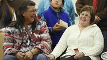 Elder Raymond Robinson shares a laugh with Attawapiskat Chief Theresa Spence on Jan. 24, 2013, after Ms. Spence ended her six-week hunger strike in Ottawa. (CHRIS WATTIE/REUTERS)
