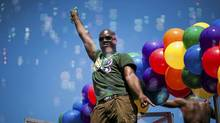 People dance on a float as it passes by during the annual Vancouver Pride Parade in downtown Vancouver, British Columbia, Sunday, July 31, 2011. (Rafal Gerszak/The Globe and Mail/Rafal Gerszak/The Globe and Mail)