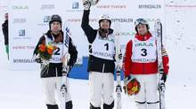 Gold medalist Mikael Kingsbury of Canada flanked by silver medalist and compatriot Alex Bilodeau (Hakon Mosvold Larsen/The Associated Press)